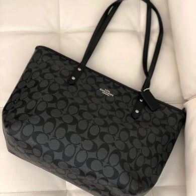 COACH iconic signature print coated canvas handbag in black - mystic-beauty-international-make-up-store