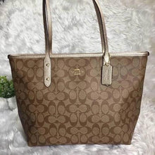Load image into Gallery viewer, COACH signature coated canvas handbag in light brown with gold trimming - mystic-beauty-international-make-up-store