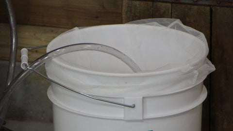 Fermentation Bucket with Cheesecloth