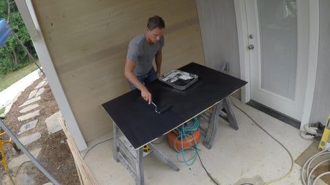 applying second coat of chalkboard paint