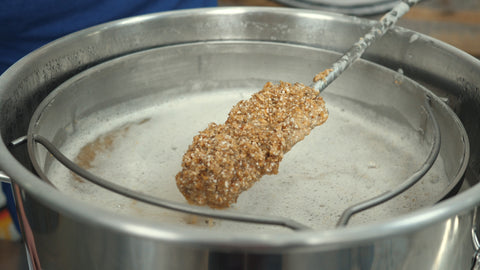 grains on a mash paddle
