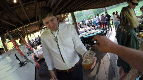 ross pouring the tripel at a wedding
