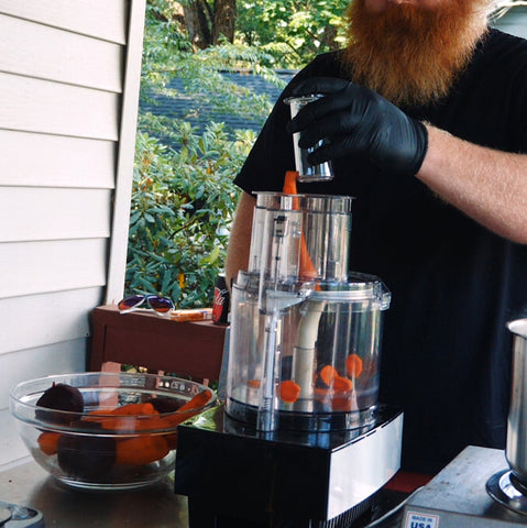 putting a carrot in a food processor