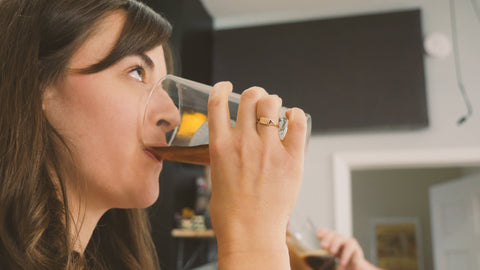 Rachael drinking extract brown ale