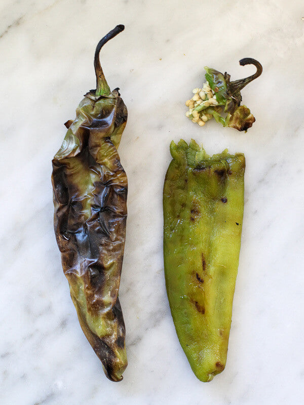 2 roasted jalapeño, one has a separated stem