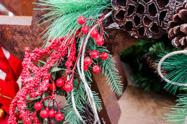 Holiday wreath with red berries and pine
