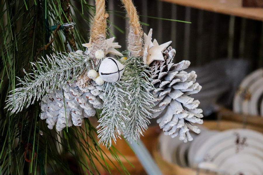 Natural Frosted Cluster décor with bells, pine cones and evergreen