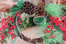 Pine Wreath with frosted leaves and red berries