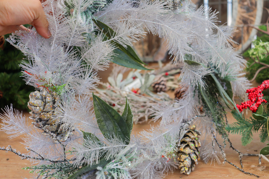 Crystalized wreath with gold pine cones