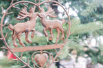 Brown metal heart with deer kissing
