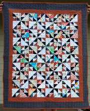 Load image into Gallery viewer, Brown and black scrappy lap quilt