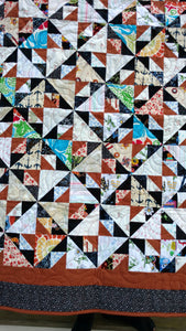 Brown and black scrappy lap quilt