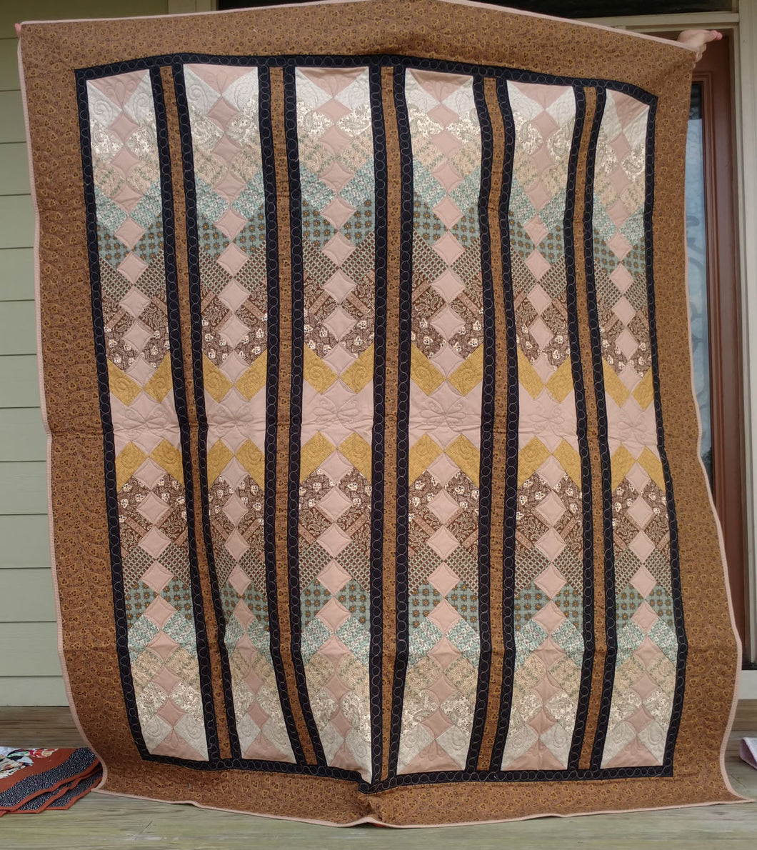 Brown French Braid lap quilt