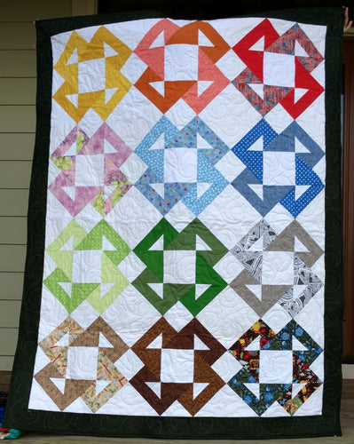Scrappy rainbow crosses lap quilt