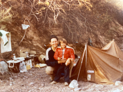 Father and son canoe up the Colorado River trip, camping along the way.
