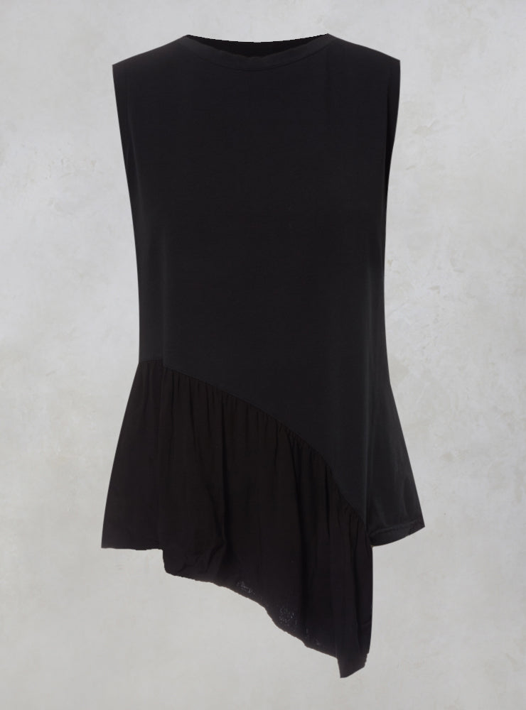 Tornado Sleeveless Top with Asymmetic Peplum in Nero
