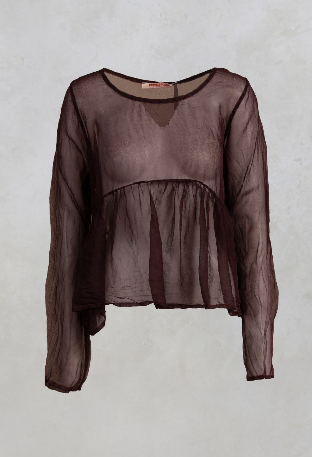 Sheer Peplum Top in Hildegard