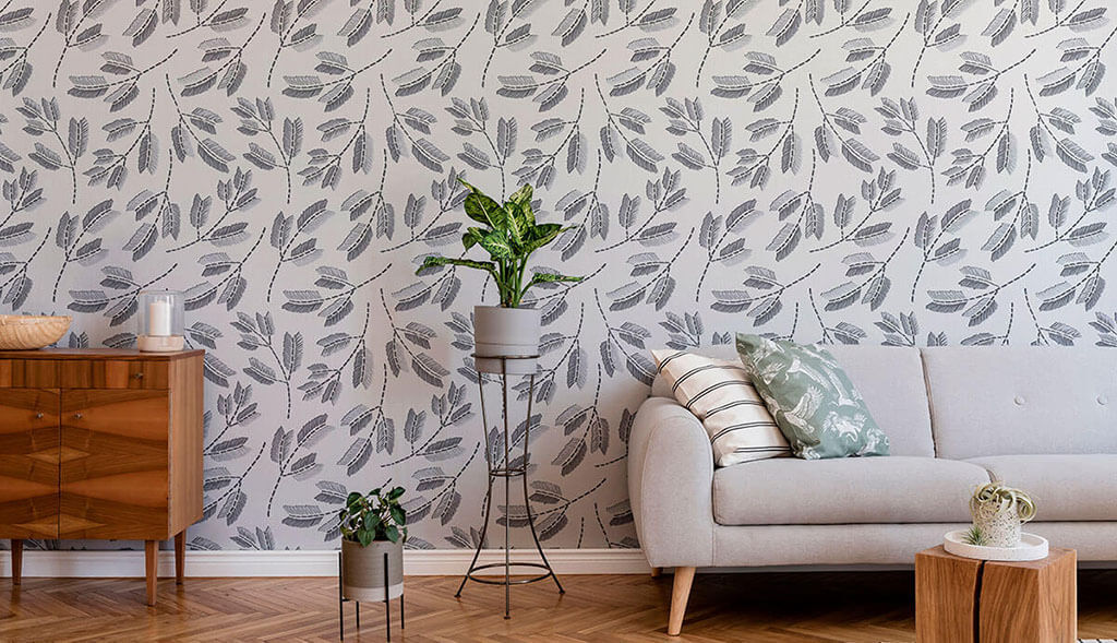Decorating a minimalist living room with grey leaves wallpaper.