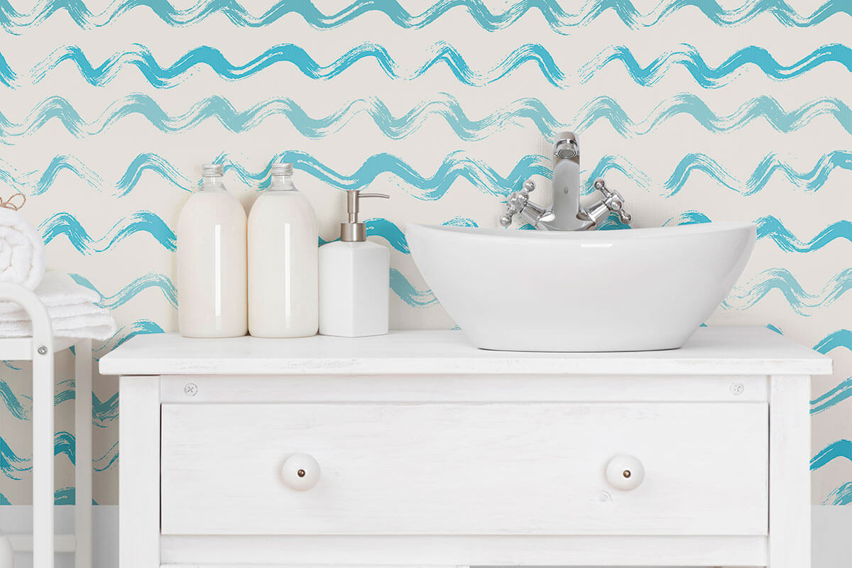 A nautical-themed white sink resembling waves on the wall