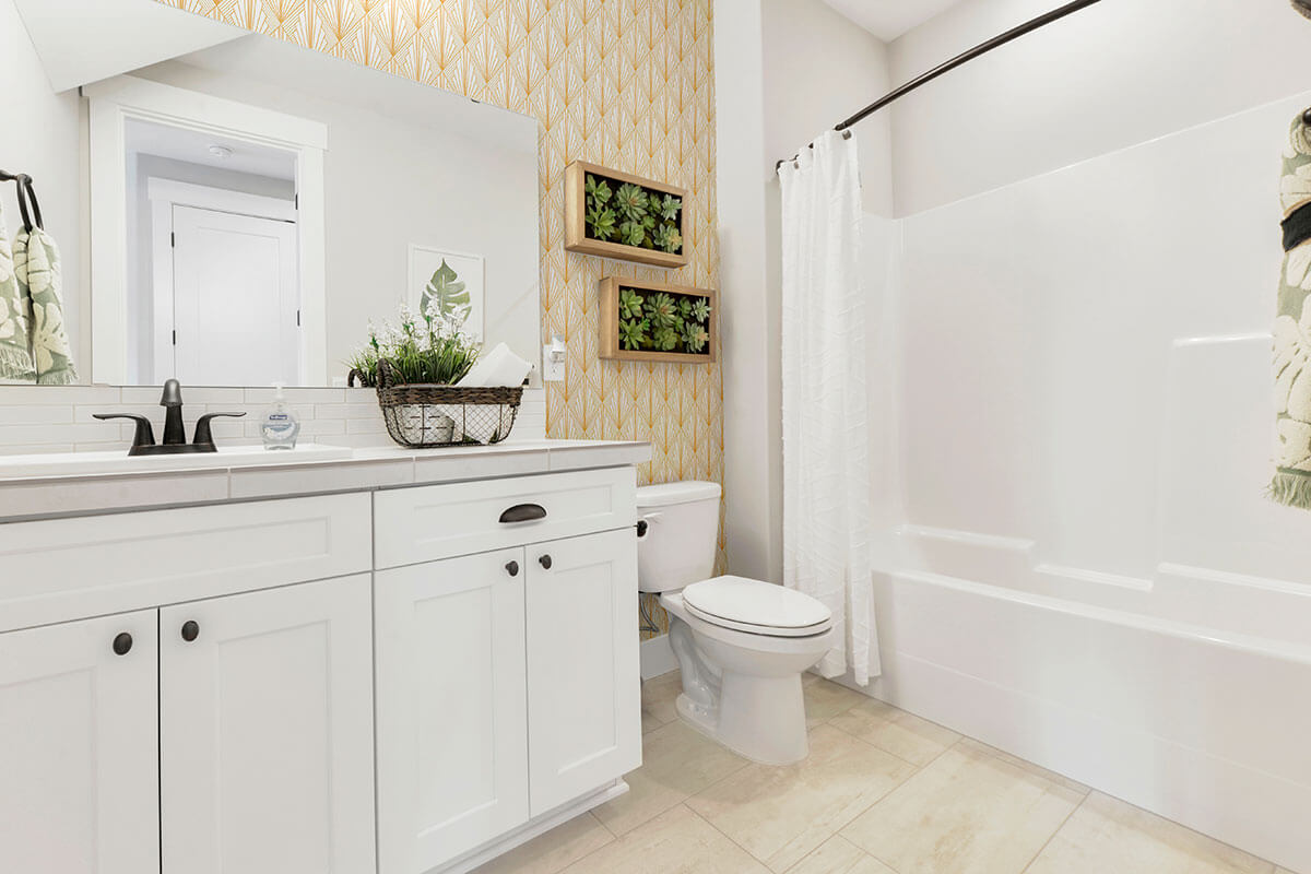 Large bright and light bathroom with peel and stick art deco wall clad in golden color