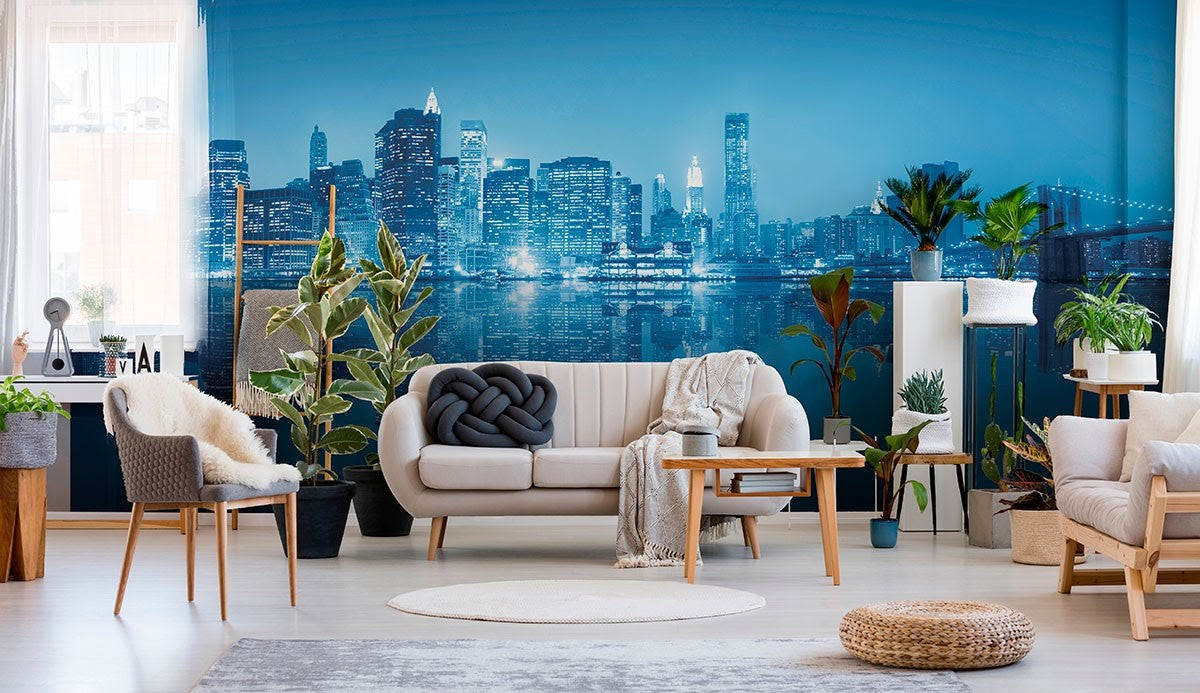 A striking blue city landscape accent wall in a living room