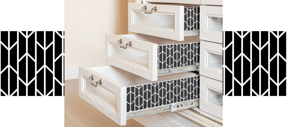 Kitchen drawers decorated with black and white geometric wallpaper