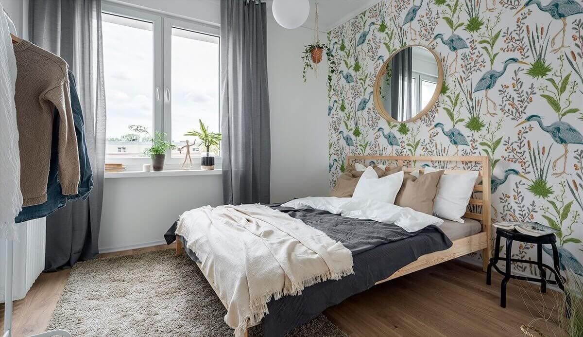 A light bedroom with a bold animal print feature wall