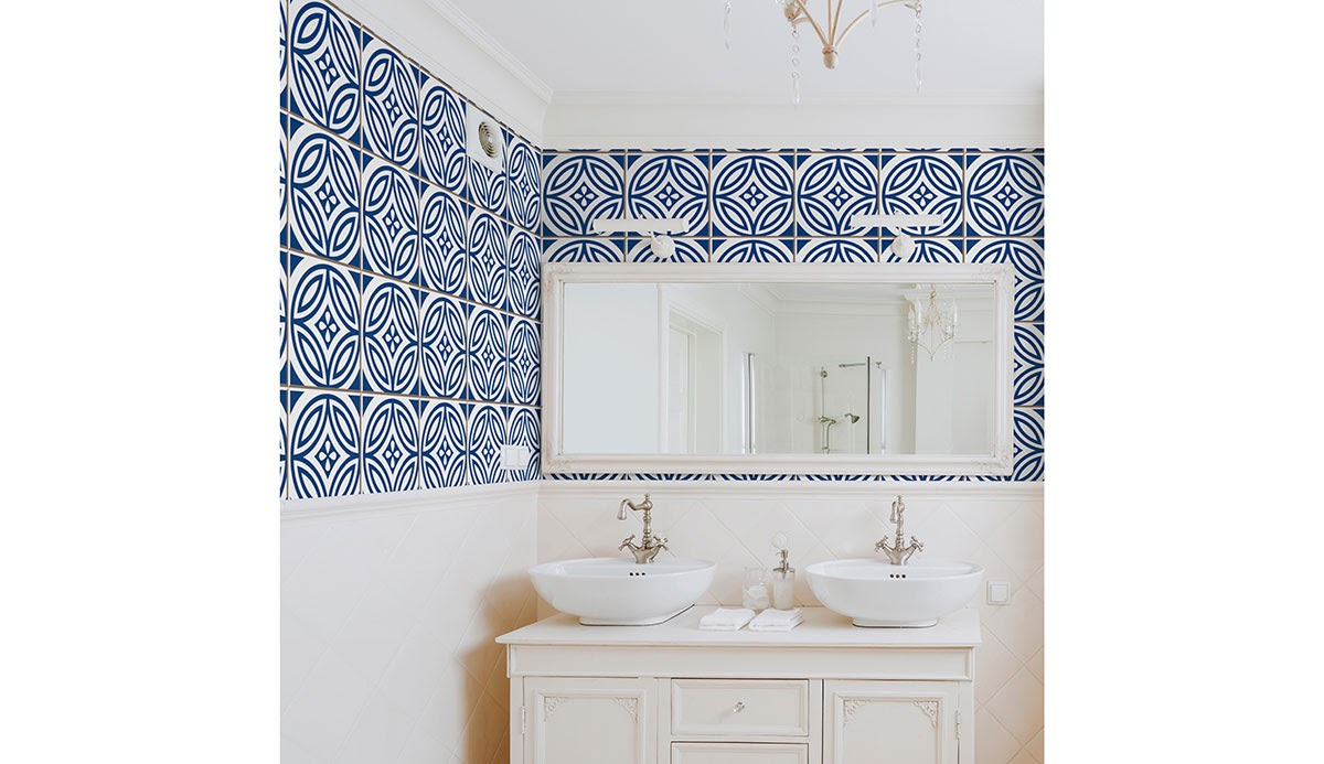 Blue and white tile-effect wallpaper in a simple white bathroom