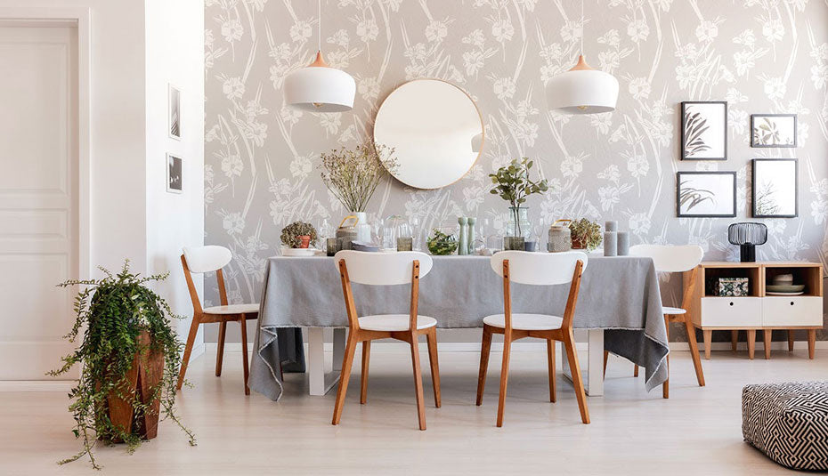 Dining room with grey floral peel and stick wallpaper.