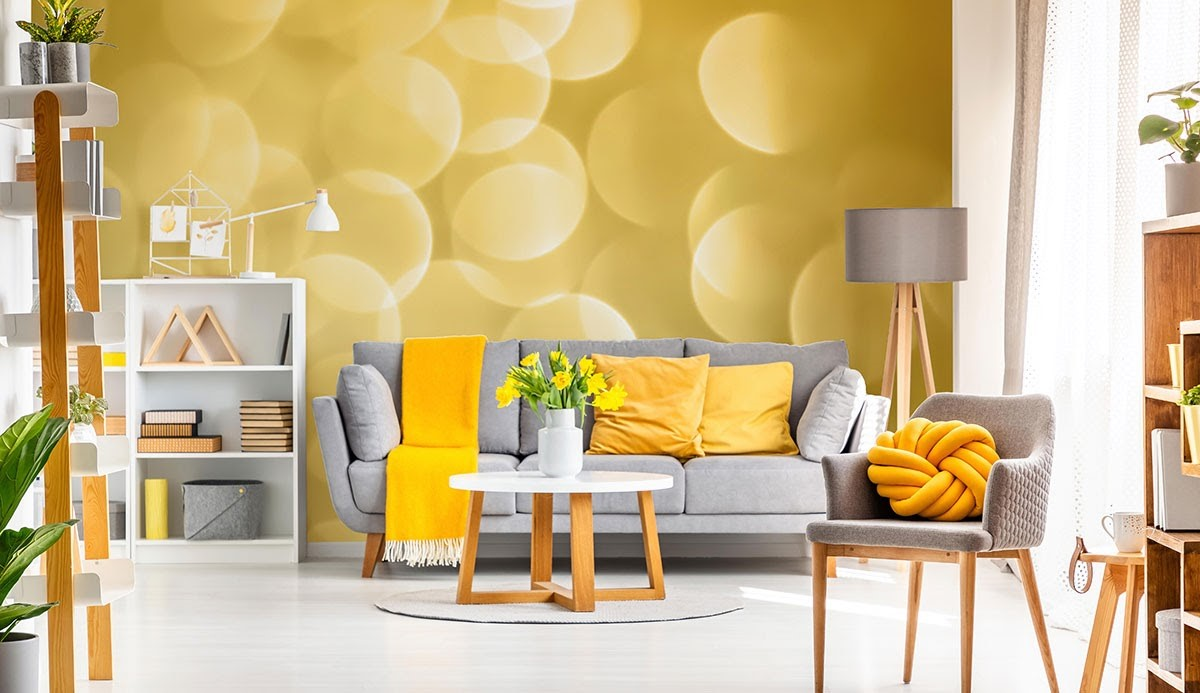 A bright, bold living room featuring golden orb wallpaper