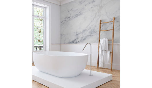 A minimalist bathroom with a marble effect wallpaper