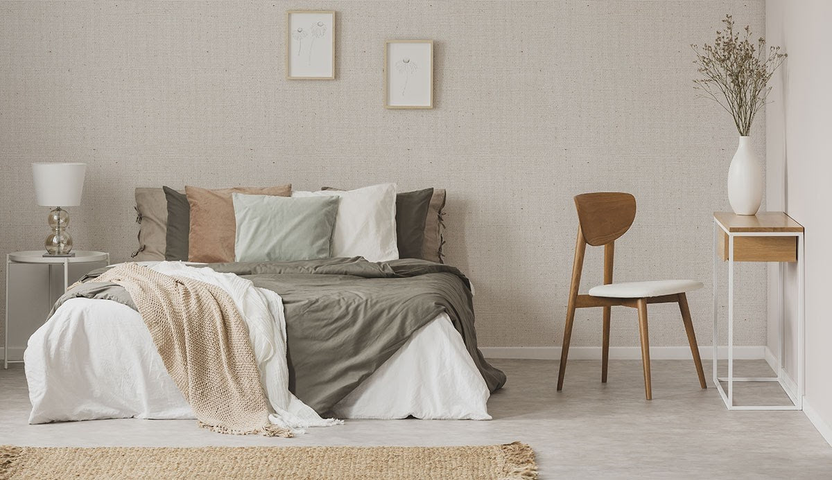 A bedroom featuring neutral and earth tones