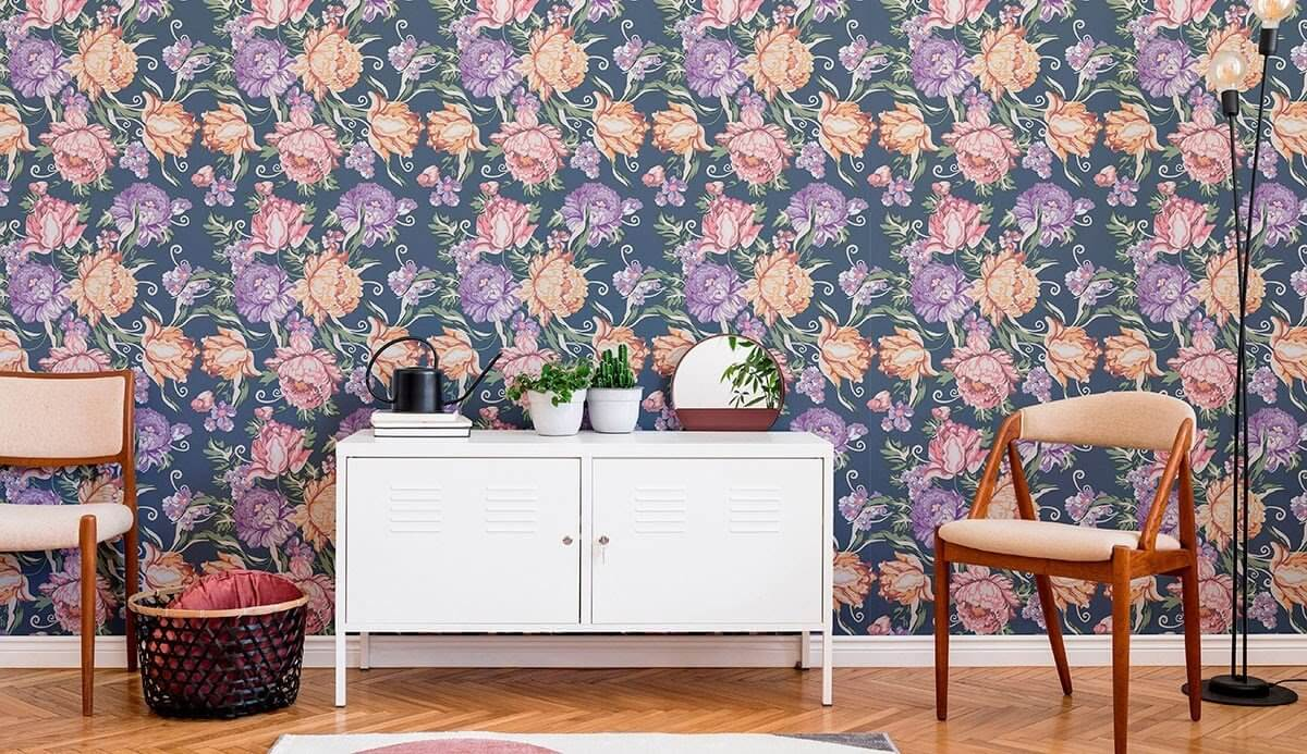 Bold floral wallpaper, two chairs, and a white cabinet