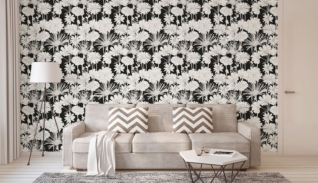 A living room with a near-monochrome look with a floral wallpaper accent wall