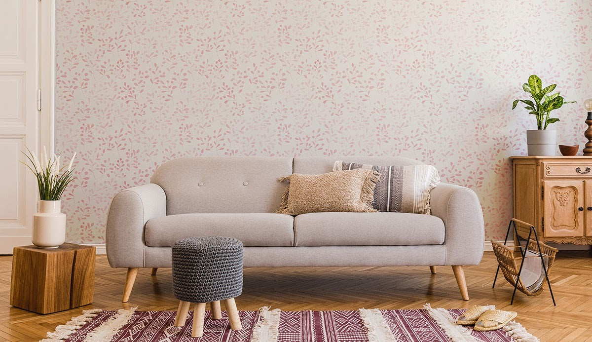 Pink and white floral wallpaper in a living room