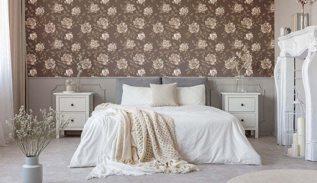 A bedroom featuring a brown floral accent wall