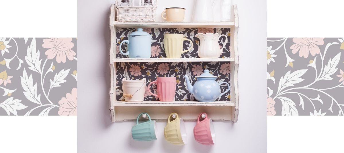 Floral wallpaper decorating the background of kitchen shelving