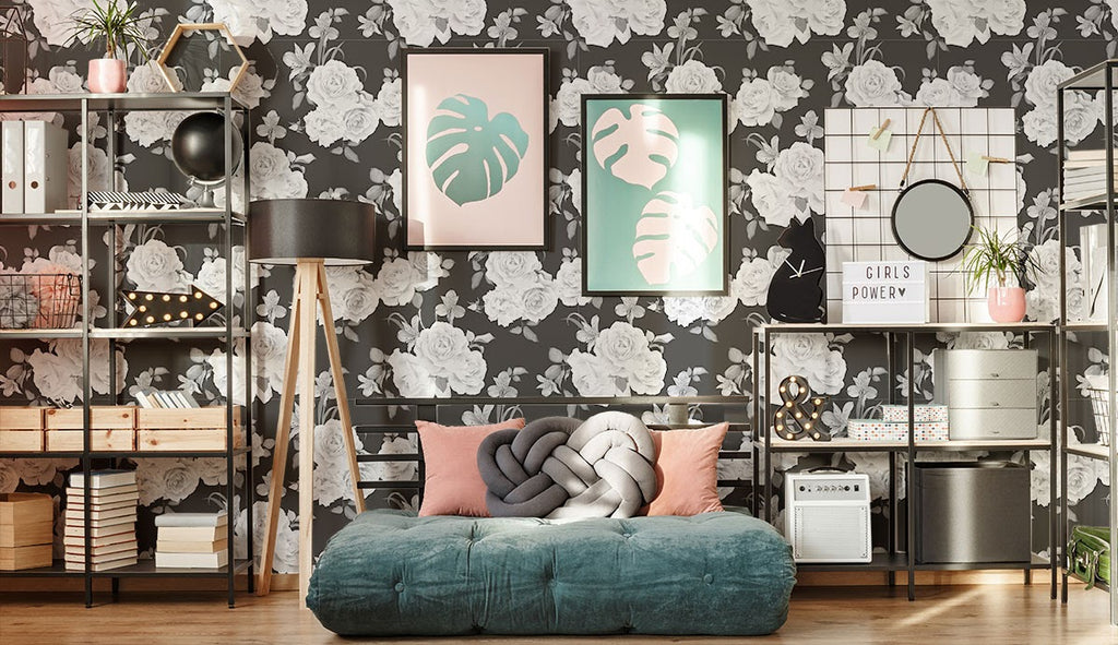 Black and white wallpaper and busy decor in a bedroom