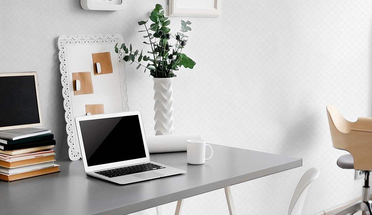 A white and metallic themed minimalistic home office