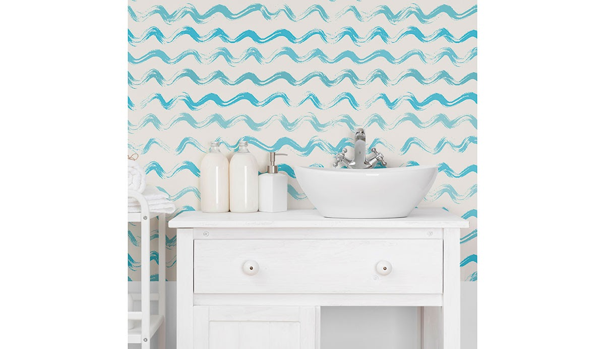 A light bathroom featuring blue wave-effect wallpaper
