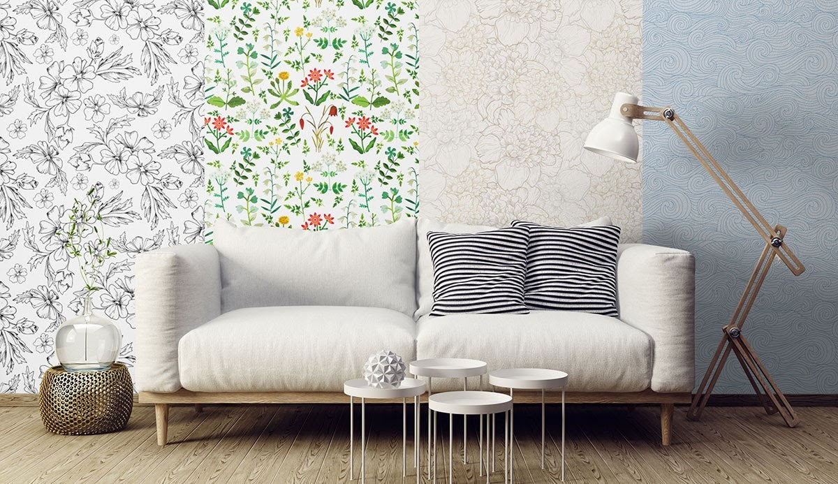 A light colored couch with four sections of different wall patterns behind it