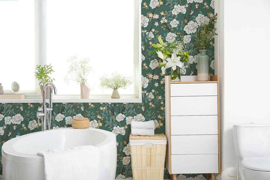 A bathroom decorated with bold, green floral wallpaper.