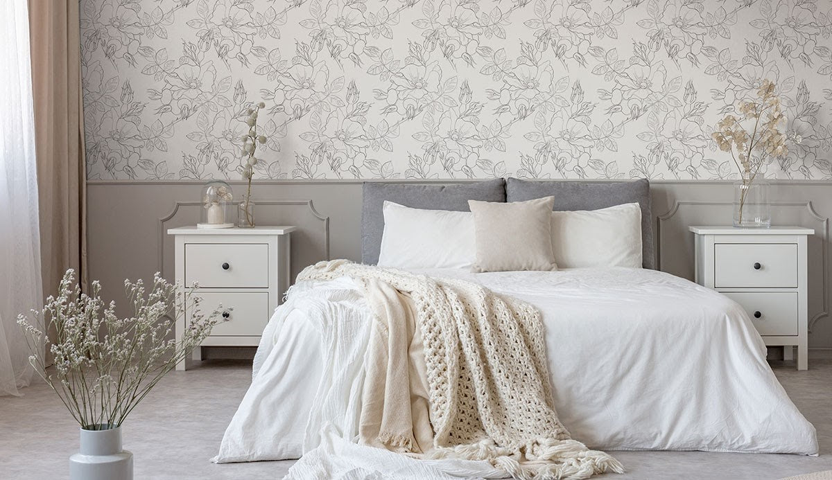 A bedroom featuring light neutral colors