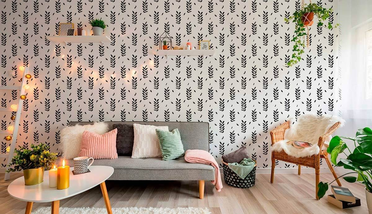 Black and white leaves wallpaper in a soft chic living room.