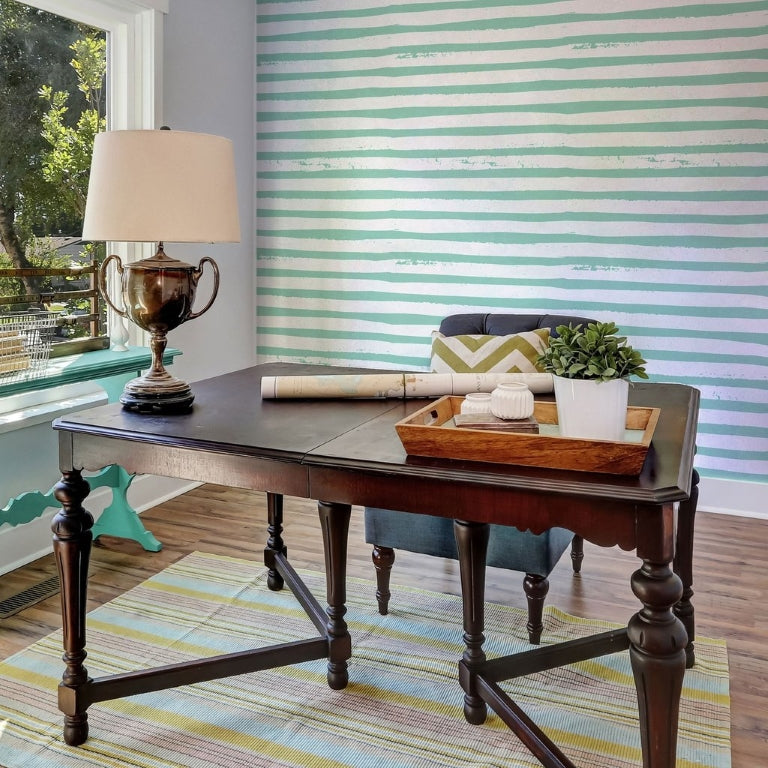 vintage look work table with blue striped wallpaper