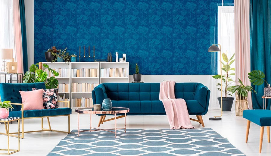 Deep blue and light pink decor in a living room