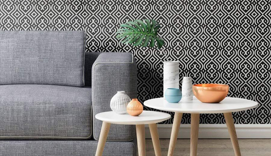 A bold geometric wallpaper in a seating area.