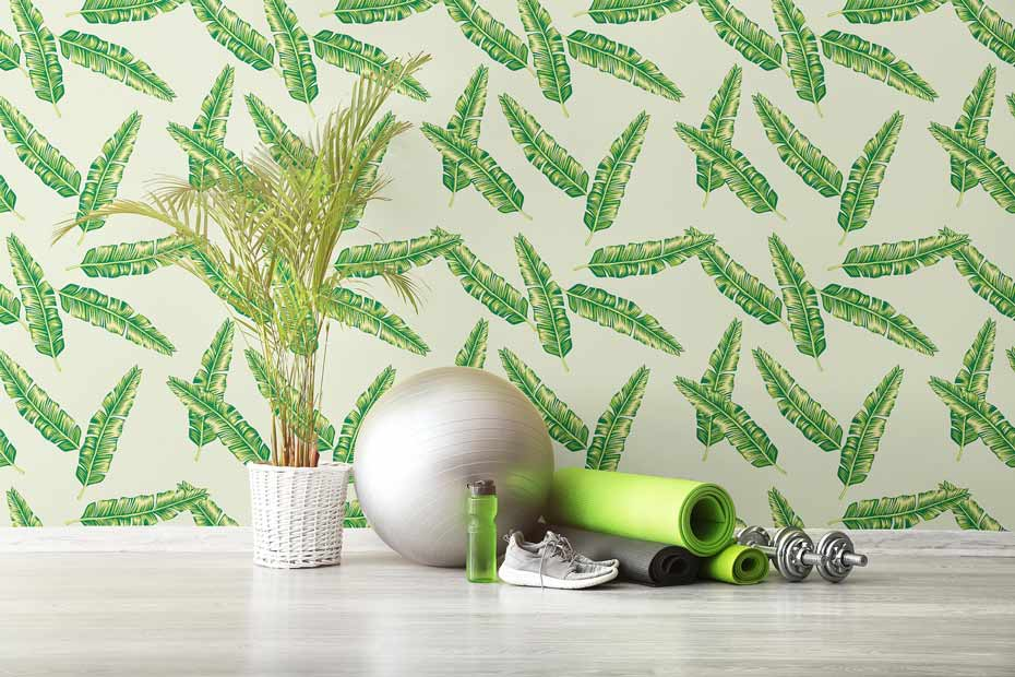 Vibrant botanical peel and stick wallpaper in a home gym