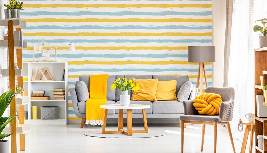 A bright, cheerfully decorated living room using spring decor ideas.