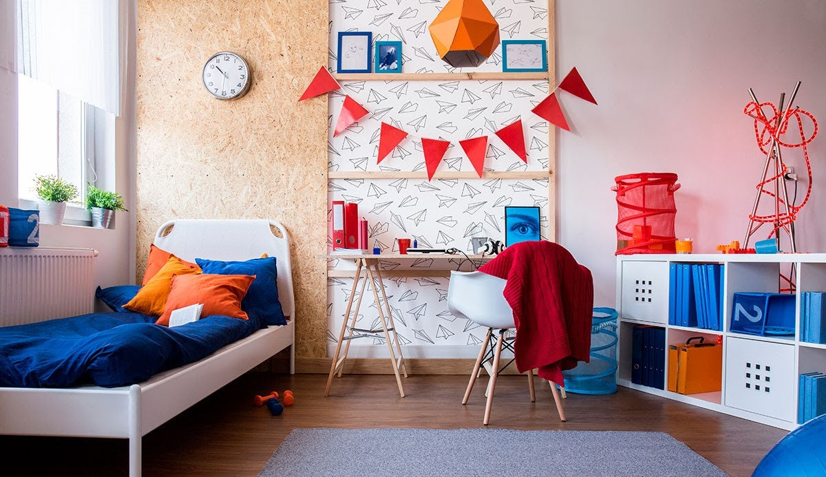 A child's bedroom decorated in bold colors